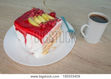 A piece cake on dish with currant in a relaxing time. Piece cake on white plate with fork