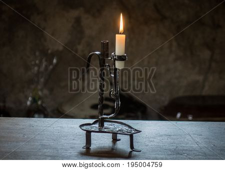 The Burning Candle In An Old Candlestick
