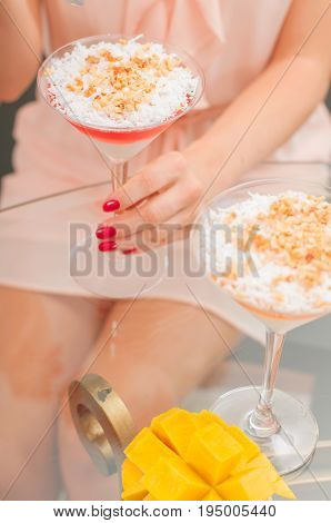 Panna Cotta Dessert With Fruit Jelly. Woman Eating Dessert.