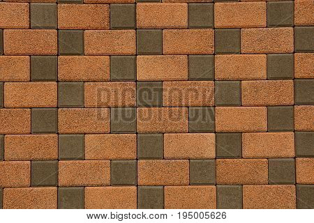 Brown texture of stone paving slab on the road