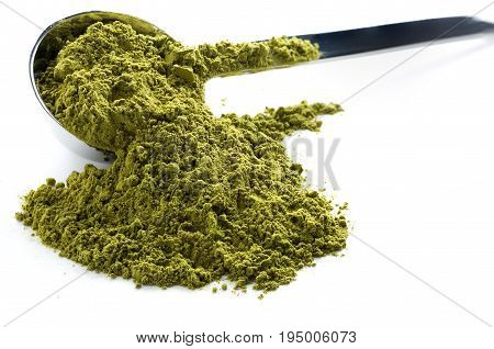 Heap of green matcha tea isolated on white background