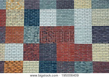 Bright colored texture of a wall made of rectangular multi-colored bricks