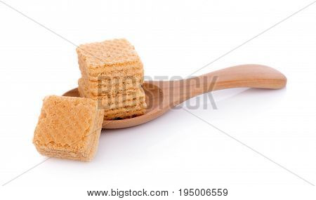Closeup Milk wafers cubes on spoon isolated