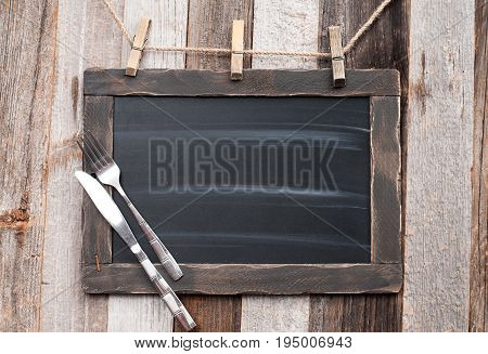 Menu Blackboard With Fork And Knife On Wooden Background