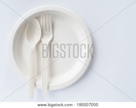 bioplastic spoon fork biodegradable plate on white background