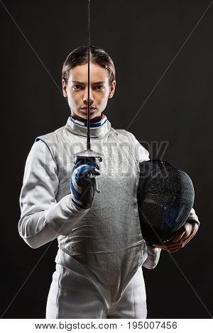 Young Woman Fencer In White Fencing Costume