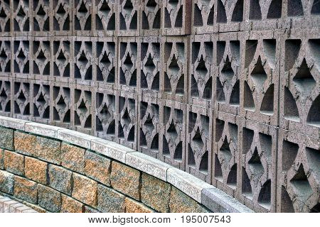 Beautiful stone fence with a pattern and bricks