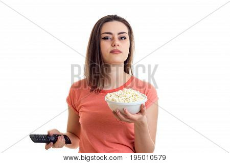 Portrait of a cute young lady that stretches in the hand of popcorn isolated on white background