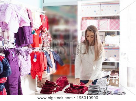 Portrait of woman-seller that preparing clothes in boutique