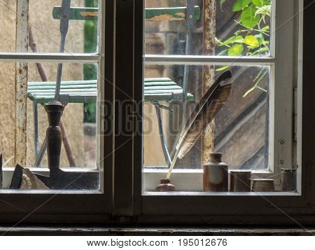 The Window With Quill Pen Of An Old Farmhouse Inside