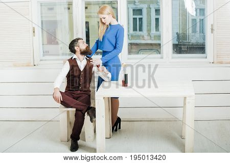 Woman Standing At Man Drinking Red Wine