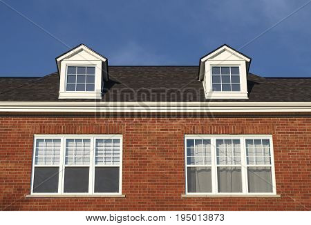 residential roof with dormers red brick habitation modern apartment