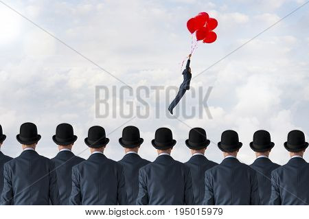 business pioneer concept businessman flying away with balloons