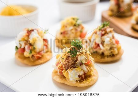 Sev Btata Puri / sev puri / papdi chat - popular indian snacks item  - Indian street food, selective focus