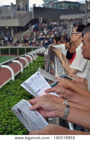 People Gambling On Horse Racing
