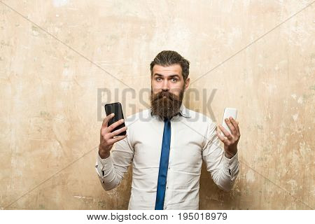 Bearded Man Or Hipster Compare Mobile Phone And Smartphone