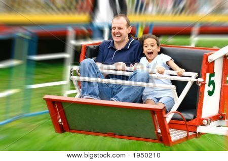 Faces of excitement from a father and daughter as they enjoy the fast octopus ride in the park poster