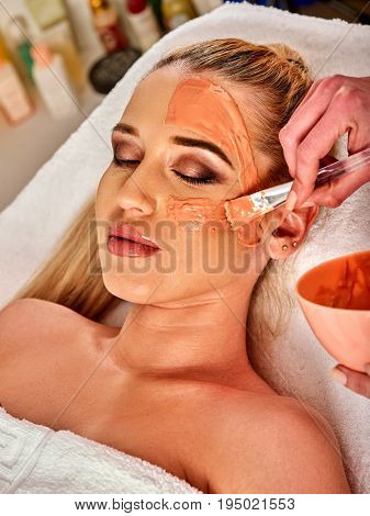 Collagen face mask. Facial skin treatment. Face of woman receiving cosmetic procedure in beauty salon close up . Paraffin mask for skin.