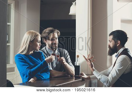 Woman And Man Toasting Glasses Of Wine At Bar