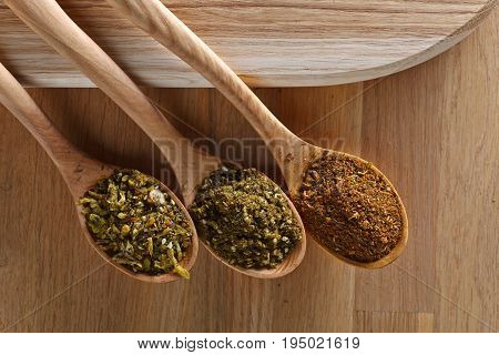 Wooden Spoons With Mixture Of Different  Spices.