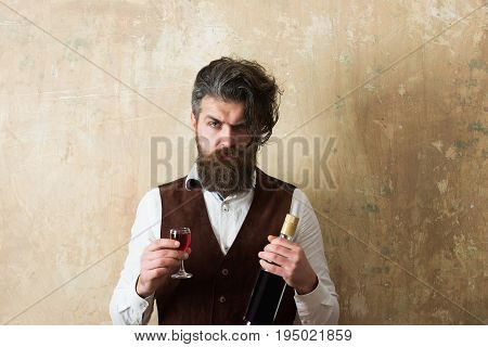 Man Holding Bottle And Glass Of Wine