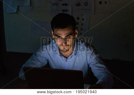 businessman working overtime in nighttime at the office.