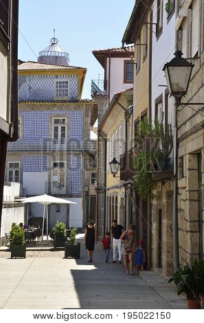GUIMARAES, PORTUGAL - AUGUST 9, 2015: People in street of the old town of Guimaraes Portugal. It is Unesco World Heritage Site.