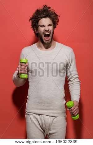 Shouting Or Yawning Man With Barbell Doing Morning Exercise