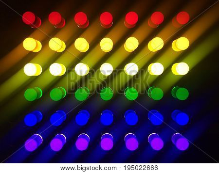 Glowing background in rainbow pattern. Luminous background of plastic cylinders in rainbow colors