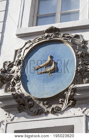 PRAGUE CZECH REPUBLIC - MAY 1  2017: Relief on facade of old building birds Nerudova street. Townhouses in Prague are often decorated with charming decorations: bas-reliefs statues and others