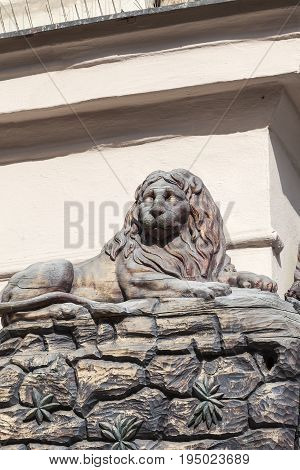 PRAGUE CZECH REPUBLIC - MAY 1  2017: Relief on facade of old building wooden lion. Townhouses in Prague are often decorated with charming decorations: bas-reliefs statues and others