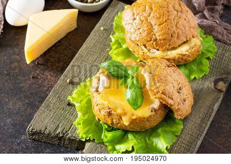 Delicious Baked Burger From Bacon, Eggs, Cheese Served With Fresh Lettuce Leaves. Ingredients For Co