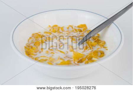 Cornflake with milk on bowl isolated on white