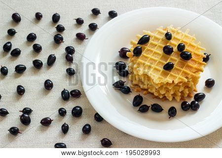 Liege waffles with berries on a napkin