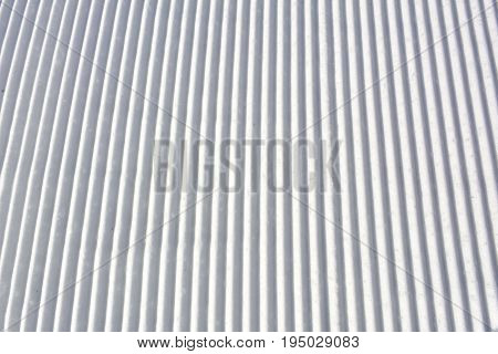 Snow lines made from a snow machine on a ski