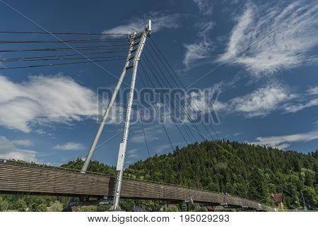 Bridge in Cerveny Klastor and Stromowce Nizne with blue sky after storm