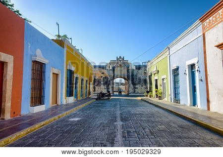View of a colorful street with a fort in Campeche Mexico