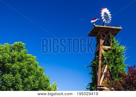 Large Wooden Tower With Water Tank & Patriotic Weather Vane