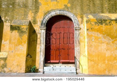 Red door of a church in downtown Campeche Mexico