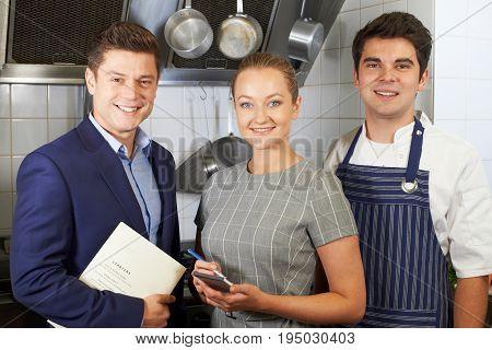 Portrait Of Restaurant Team Standing In Kitchen