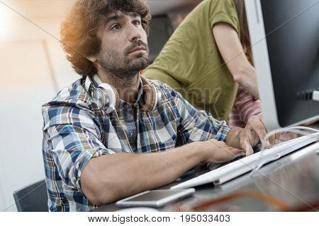 Startup entrepreneur working on desktop in office