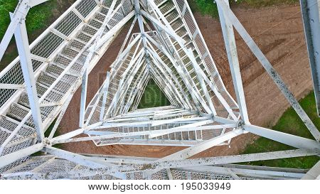 View from above through a metal lattice from the tower