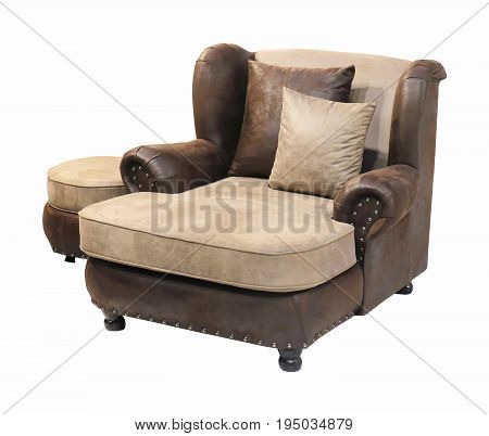 Leather armchair with ottoman and pillows isolated with clipping path