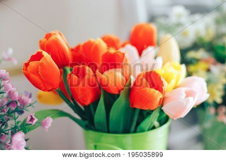 Artificial decArtificial decorative pink red and yellow tulips in a vaseorative pink tulips