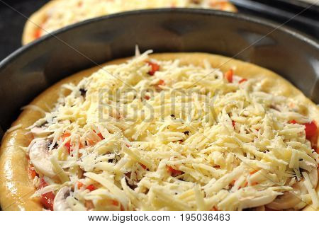 Homemade Pizza, Process Of Cooking. Layer Of Grated Cheese