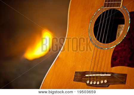 Guitar and fireplace