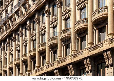 Neoclassicism building facade of Institute of Statistics of Catalonia Spain. Abstract background pattern.