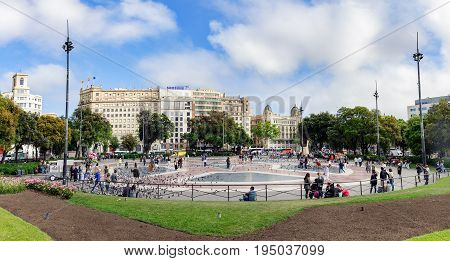 BARCELONA, SPAIN - AUGUST 17: People are walking at Placa Catalunya in Barcelona, Spain. This square is considered to be the city center.