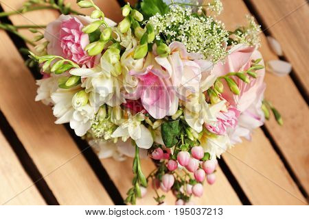 Beautiful bouquet with freesia flowers on table