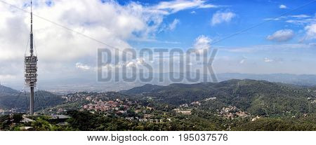 Aerial panoramic view on Telecommunication tower and Barcelona town from Tibidabo mount, Spain